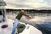 WA11861-00...WASHINGTON - Jim Johansen places a shrimp pot in the Puget Sound.  (MR# J5)