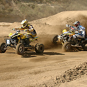 Don Jr Lysinger (#411) attempts to hold off Jason Luburgh (#8) in the Saturday qualifier.
