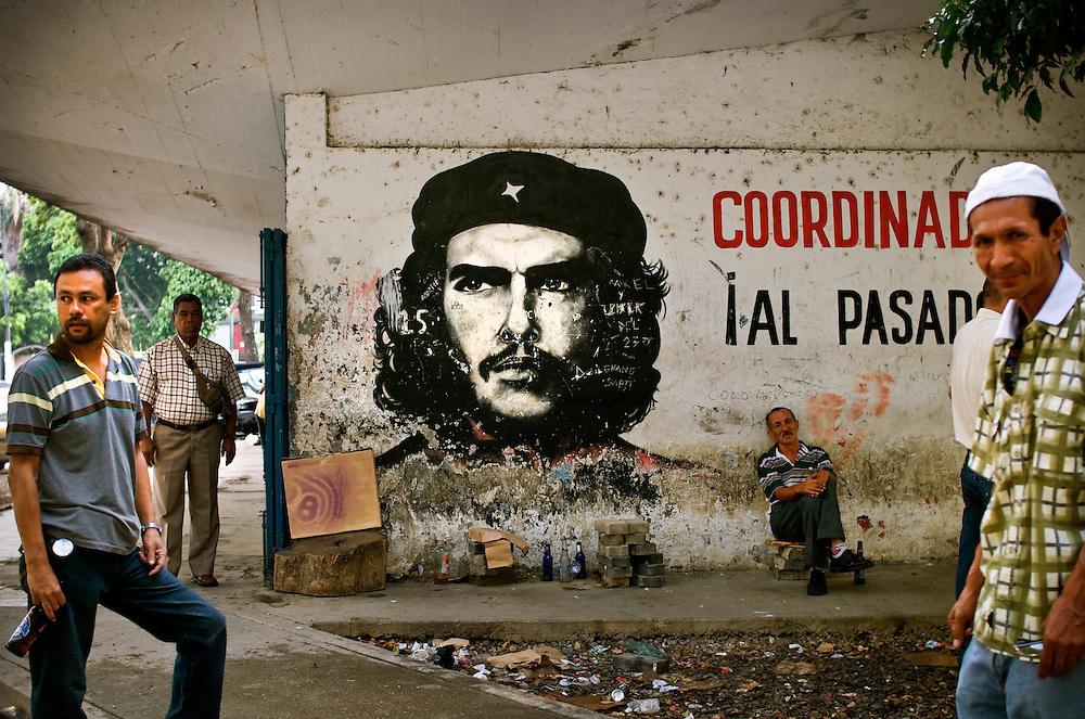 "Urban street art depicting Ernesto ""El Che"" Guevara in 23 de Enero, a slum in Caracas, Venezuela legendary for being the pulse of Hugo Chávez's Bolivarian Revolution. Guevara, an Argentine Marxist, was a major figure in the Cuban Revolution. His iconic image may be found painted on public walls in various pro-government slums in Caracas as a symbol of the political allegiance between Cuba and Venezuela. There has recently been an increase of rumbling in Venezuela's military over the presence of and influence wielded by Cuban advisers invited to Venezuela by President Hugo Chávez."