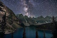 The summer Milky Way over Moraine Lake, in Banff National Park, Alberta, from the classic viewpoint on the rock &ldquo;moraine&rdquo; hill &ndash; it is actually the result of a rockslide not a glacial moraine. This is looking southwest with the images taken about 11:15 pm on August 31, 2016 on a rare clear night in the summer of 16! The ground is illuminated by a mix of starlight, lights from the Moraine Lake Lodge, and from a display of aurora brightening behind the camera to the north. Indeed, I had to neutralize the green cast out of the mountains caused by the aurora. <br /> <br /> The starclouds of Scutum and Sagittarius are just above the peaks of the Valley of Ten Peaks.<br /> <br /> This is a stack of 16 images for the ground, mean combined to smooth noise, and one exposure for the sky, untracked, all 15 seconds at f/2 with the Sigma 20mm Art lens and Noikon D750 at ISO 6400. The frames are part of a 450-frame time-lapse.