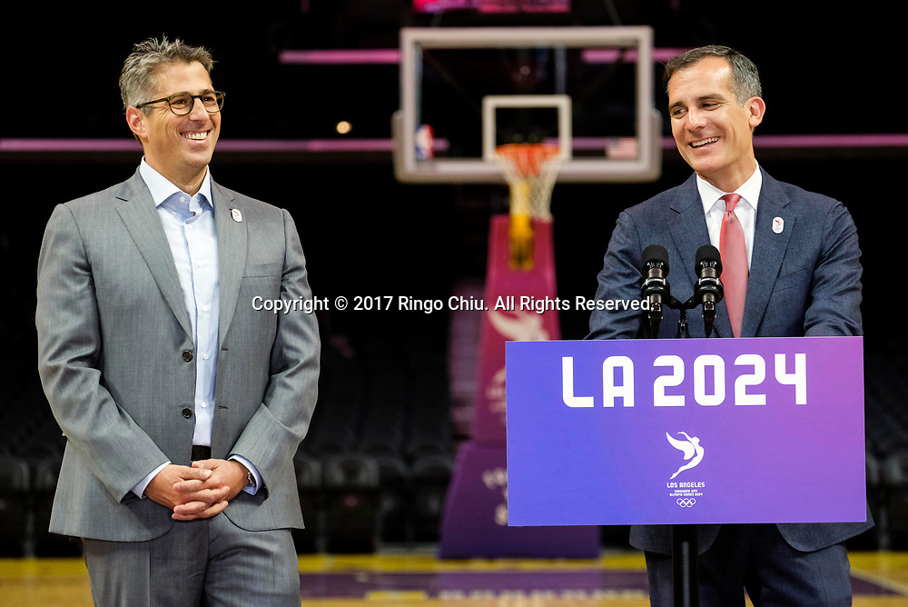 Los Angeles 2024 Chairman Casey Wasserman, left, and  Los Angeles Mayor Eric Garcetti, share a laugh in a news conference at Staples Center, Friday, May 12, 2017, in Los Angeles, the United States. A team of International Olympic Committee delegates wrap up their a three-day tour of Los Angeles as the city attempts to demonstrate its readiness to stage the 2024 Olympics.<br />   (Xinhua/Zhao Hanrong)(Photo by Ringo Chiu/PHOTOFORMULA.com)<br /> <br /> Usage Notes: This content is intended for editorial use only. For other uses, additional clearances may be required.