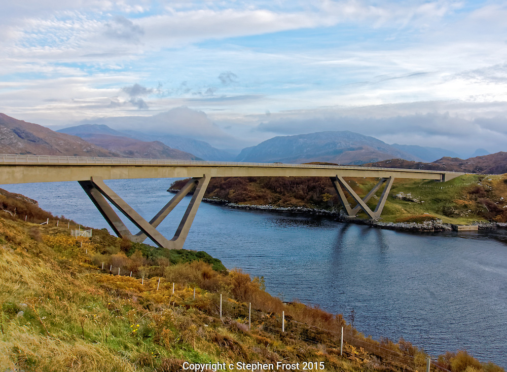 Kylesku Bridge is a distinctively curved concrete box girder bridge in north-west Scotland that crosses the Loch a' Chàirn Bhàin in Sutherland.