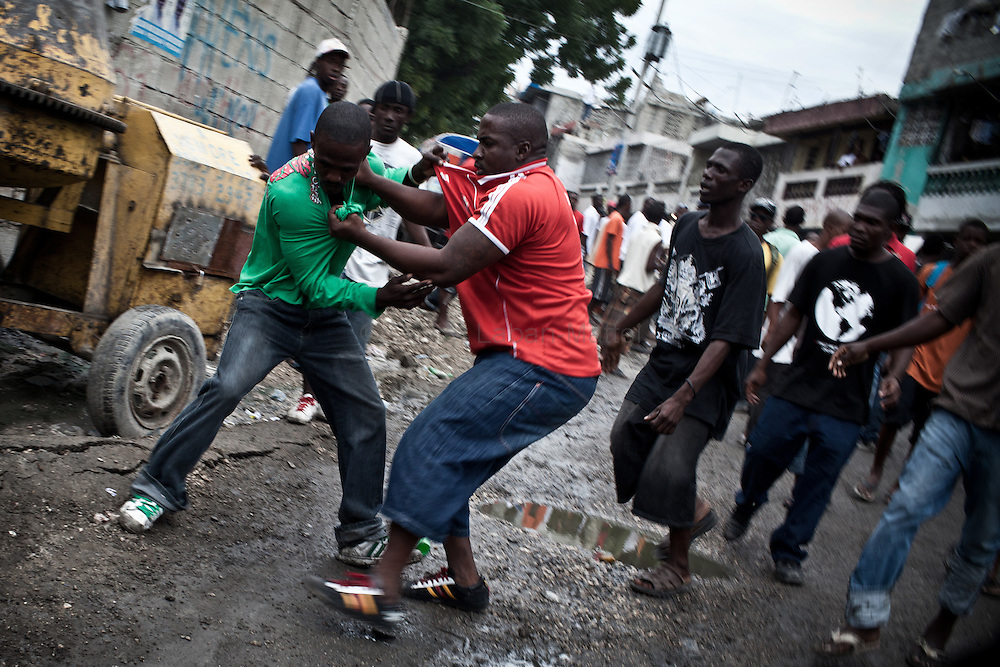 Celestin's supporters fight each others during a demonstration, in the streets of Port-au-Prince, to celebrate the results of their leader, Jude Celestin.