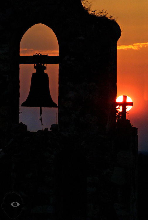 The sun sets behind the centuries old San Miguel Arcangel Church in Mani, Yucatan.
