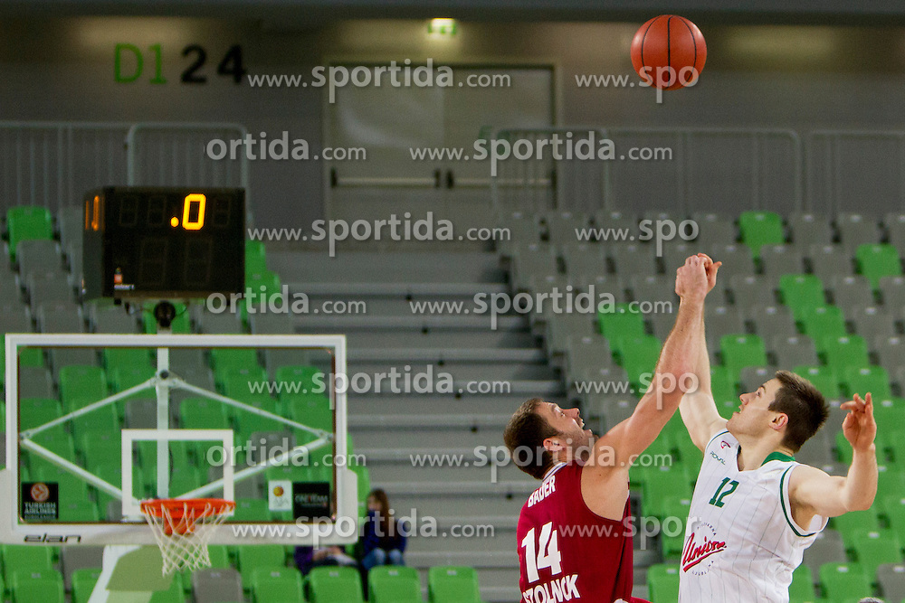 Bader Marton #14 of BC Szolnoki Olaj and Baynes Aron #12 of KK Union Olimpija during basketball match between KK Union Olimpija (SLO) and BC Szolnoki Olaj (HUN) in 8th Round of ABA Leaugue 2012/13 on November 11, 2012 in Arena Stozice, Ljubljana, Slovenia. (Photo By Urban Urbanc / Sportida)