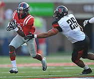 Mississippi running back Jeff Scott (3) runs against Southeast Missouri State's Matt Starks (25) at Vaught-Hemingway Stadium in Oxford, Miss. on Saturday, September 7, 2013. (AP Photo/Oxford Eagle, Bruce Newman)
