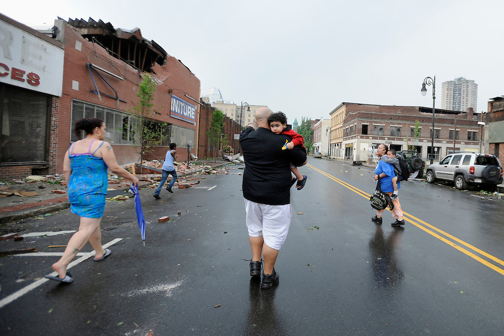 People seek cover after an announcement of another possible tornado in Springfield, Mass., Wednesday, June 1, 2011.  An apparent tornado struck downtown Springfield, one of Massachusetts' largest cities, scattering debris, toppling trees, and frightening workers and residents. (AP Photo/Jessica Hill)