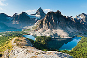 The shoulder of Nub Peak gives an impressive view of Mount Assiniboine (3618 meters / 11,870 feet) and Wedgewood Peak rising above Lake Magog, Sunburst Lake, and Cerulean Lake (left to right) in Mount Assiniboine Provincial Park, British Columbia, Canada. This is part of the Canadian Rocky Mountain Parks World Heritage Site declared by UNESCO in 1984.