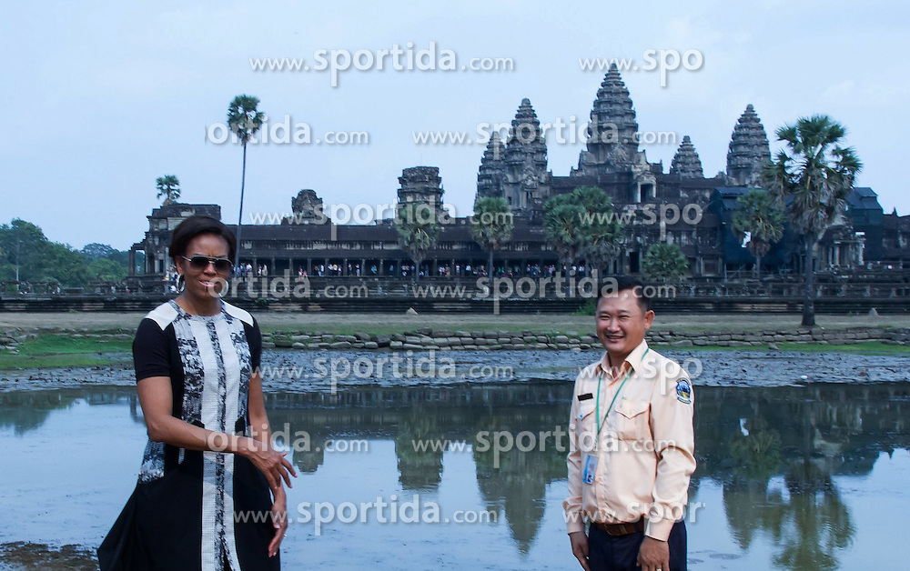 U.S. first lady Michelle Obama (L) poses for photos in front of the Angkor Wat Temple in Siem Reap province, Cambodia, March 21, 2015. U.S. first lady Michelle Obama visited Cambodia's famed Angkor Wat Temple here on Saturday afternoon during her trip to the country to promote her &quot;Let Girls Learn&quot; global education initiative. EXPA Pictures &copy; 2015, PhotoCredit: EXPA/ Photoshot/ Sovannara<br /> <br /> *****ATTENTION - for AUT, SLO, CRO, SRB, BIH, MAZ only*****