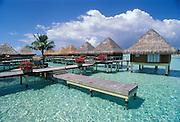 Overwater bungalows on lagoon at Intercontinental Le Moana Bora Bora resort, Tahiti..