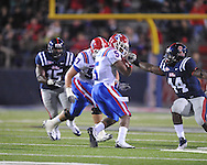 Louisiana Tech's Lennon Creer (5) has his facemask grabbed by Ole Miss' Ralph Williams (44) in Oxford, Miss. on Saturday, November 12, 2011. (AP Photo/Oxford Eagle, Bruce Newman..