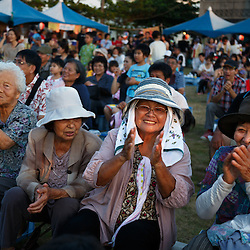 Take Yamashiro, 89, sits among friends at a festival in Ogimi, Okinawa. The island's population boasts one of the longest life spans in the world.