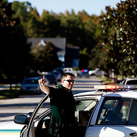 CELEBRATION, FL -- December 2, 2010 -- Sheriff deputies block off intersections a non-related standoff just days after the town's first murder in the small, Disney master-planned community in Celebration, Fla., on December 2, 2010.  The town's first murder in its 14 year existence has drawn buzz worldwide and amongst its citizens alike.