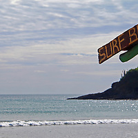 Central America, Nicaragua, Playa Remanso. Surf Beach sign on palapa at Playa Remanso.