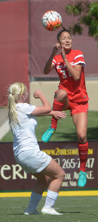 gbs092516w/SPORTS -- UNM's Isabella Jimenez, 31, goes high for a header over Air Force's Taylor Cobb during the game at the UNM Soccer Complex on Sunday, September 25, 2016. Air Force won 2-1.(Greg Sorber/Albuquerque Journal)