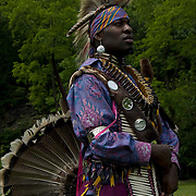 Aus Spotted Eagle (  Lipan Apache / Choctaw Nation Oklahoma and African American ), dressed in Cree Northern traditional regalia dancing in the &quot;Drums Along the Hudson&quot;, Native American Festival, Inwood Hill Park, NYC.<br /> <br /> Release 2564