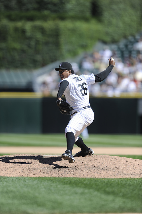 CHICAGO - JULY 23:  Octavio Dotel #26 of the Chicago White Sox pitches during the game against the Texas Rangers at U.S. Cellular Field in Chicago, Illinois on July 23, 2008.  The White Sox defeated the Rangers 10-8.  (Photo by Ron Vesely)