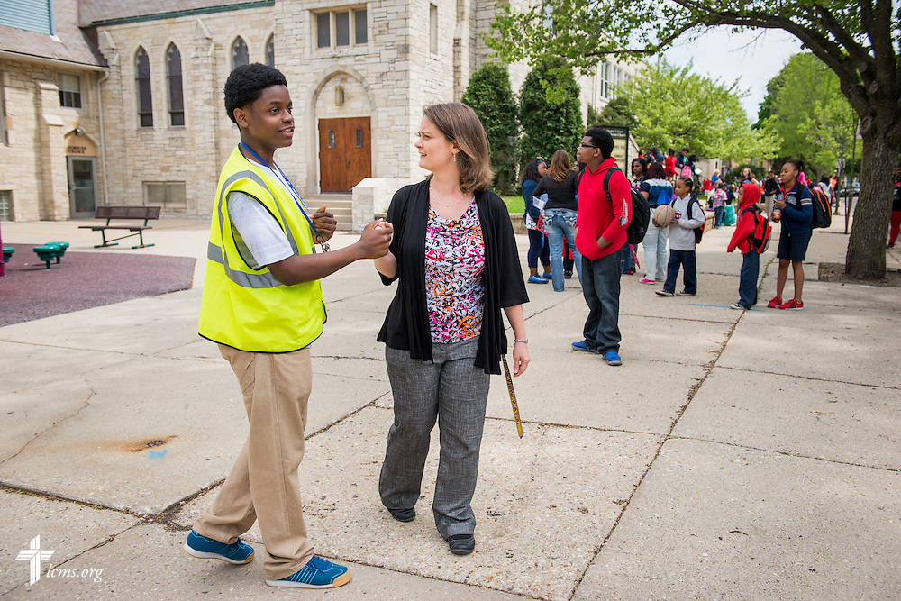 Principal Carrie Miller greets Jalen, a student assisting as a crossing guard, after class outside Mount Calvary Lutheran Church and School on Wednesday, May 28, 2014, in Milwaukee, Wis. LCMS Communications/Erik M. Lunsford