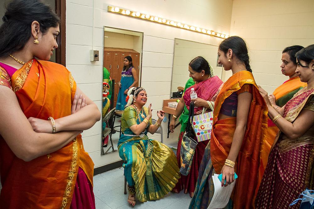 Lincroft, New Jersey, 9/20/14: Backstage before her arangetram, Hema Ramaswamy receives encouragement from friends.