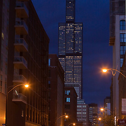 Late evening storm clouds hang over the Chicago skyline, silhouetting the Sears Tower with an ominous mood.