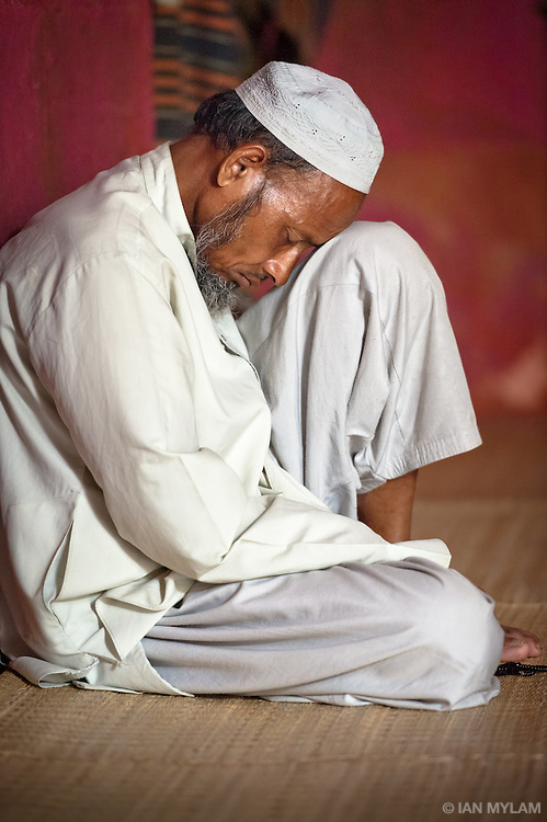 Man Praying in a Mosque - Old Delhi, India