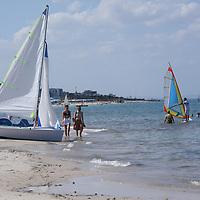 Scenes from Tunisia's resort area, El Kantouai, windsurf and sailboats on beach