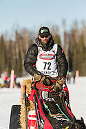 Musher Lance Mackey competing in the 44th Iditarod Trail Sled Dog Race on Long Lake after leaving the restart on Willow Lake in Southcentral Alaska.  Afternoon. Winter.