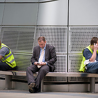 Businessman and construction workers on a lunch break in The City of London.
