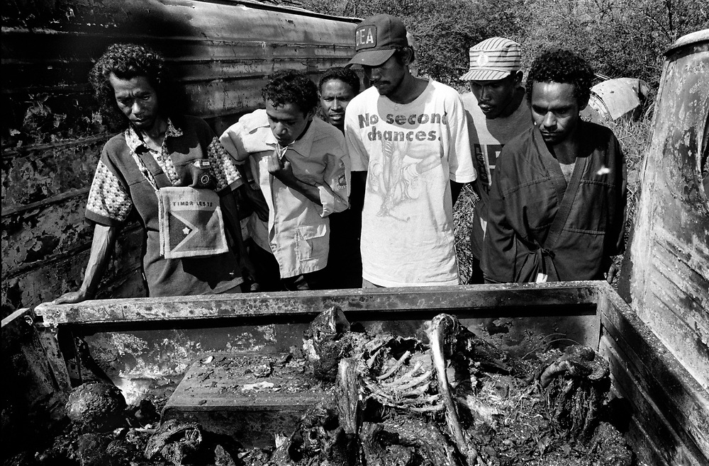 The remains of ten independence supporters, killed by Militia and rogue Indonesian forces, are found in the back of a burnt out pickup truck. Tacitolu September 26 1999