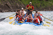 Whitewater rafting at Bonecrusher Rapids on the Flathead River with Wild River Adventures; Glacier National Park, Montana.