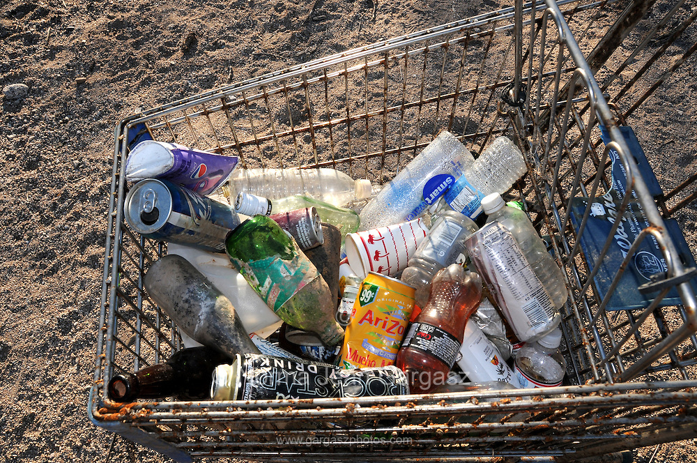 Much of the trash that was illegally dumped along a riverbed in Tucson, Arizona, USA, could have been recycled.