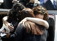 Christina Bookal (far right) is embraced by two women outside the House of Refuge after funeral services for her son Marc Bookal in the City of Newburgh, NY on Saturday, April 24, 2010. Bookal is the four year-old Newburgh boy who went missing last December 14th., and whose body was eventually recovered on March 24th. His death has been ruled a homicide.