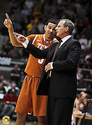 SHOT 2/26/11 4:54:06 PM - Texas head basketball coach Rick Barnes gives some instructions to Cory Joseph (#5) in the closing moments of their game against Colorado during their regular season Big 12 basketball game at the Coors Events Center in Boulder, Co. Colorado upset the fifth ranked Texas 91-89. (Photo by Marc Piscotty / © 2011)