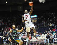 "Ole Miss' Murphy Holloway (31) vs. Coastal Carolina's Warren Gillis (0) at the C.M. ""Tad"" Smith Coliseum in Oxford, Miss. on Tuesday, November 13, 2012. (AP Photo/Oxford Eagle, Bruce Newman)"