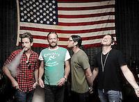 xx of Kings of Leon poses for a portrait on Thursday, Sept. 5, 2013 in Nashville, Tenn. (Photo by Donn Jones/Invision/AP)