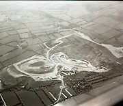 Silvermines From The Air.  (J54).1975..20.05.1975.05.20.1975..20th May 1975..Silvermines is a small village in Co Tipperary.  It lies immediately north of the Silvermine mountain range and takes its name from the extensive mines of lead, zinc, copper and silver nearby. Here is a series of images of Silvermines taken from the air. The Images show the mining area and its setting in the surrounding countryside.