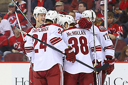 Mar 27, 2014; Newark, NJ, USA; The Phoenix Coyotes celebrate a goal by Phoenix Coyotes defenseman Chris Summers (20) during the second period at Prudential Center.