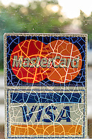 A cracked credit card sign at the Pony Island restaurant on Ocracoke Island.