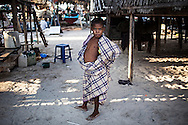 Young Bajau wearing the traditional Sarong on Mabul island