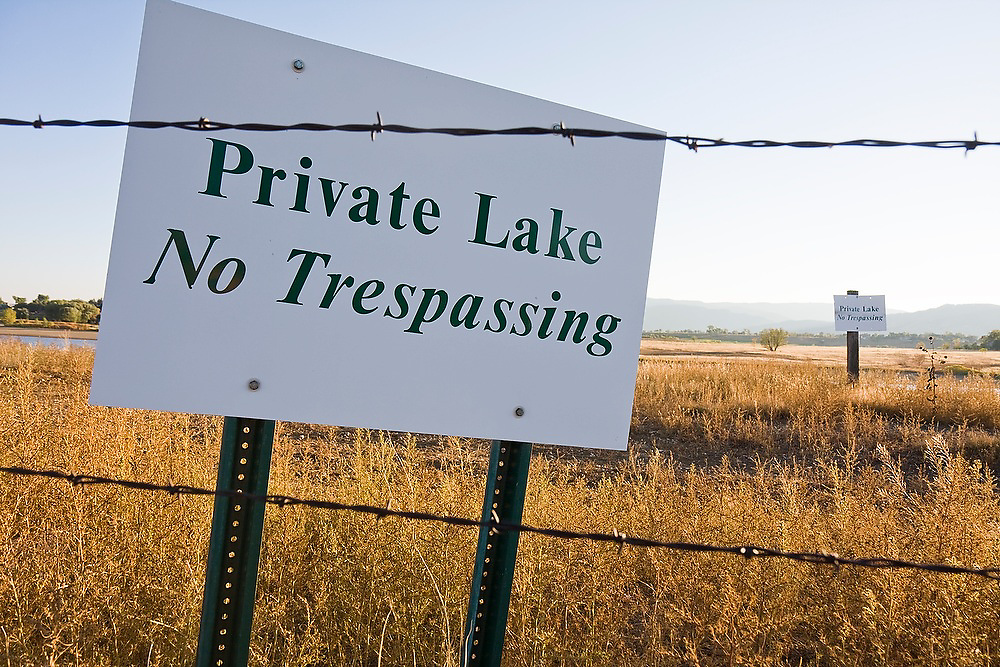 """No trespassing signs for a """"Private Lake"""" near the Boulder Reservoir outside Boulder, Colorado."""