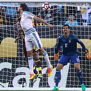 Uruguay Attacker EDINSON CAVANI (21) heads the ball toward the net as Venezuela Keeper DANIEL HERNANDEZ (12) defends in the first half of a Copa America Centenario Group C match between Uruguay and Venezuela Thursday, June. 09, 2016 at Lincoln Financial Field in Philadelphia, PA.