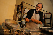 "Martano, a small town around Lecce. Luigi Baldari, famous craftsman of the papier-mâché. With the ""focheggiatura"" the papier-mâché is worked with red-hot tools to mould to the due form. The papier-mâché is obtained in a traditional way, like in Middle Age. The papier-mâché, a pulp of paper and old rags with cellulose, water and paste is boiled and pressed with animals glue and resin size to obtain a dense  pulp."