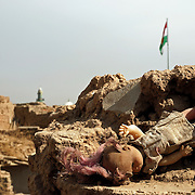 An abandoned doll in Irbil Citadel. The Iraqi Kurdistan Regional Government evicted dozens of refugee families from the historic citadel in early 2007 with the intention of turning it into a tourist attraction. As of October 2007, no effort had been made to restore the citadel, and it remained a ghost town.