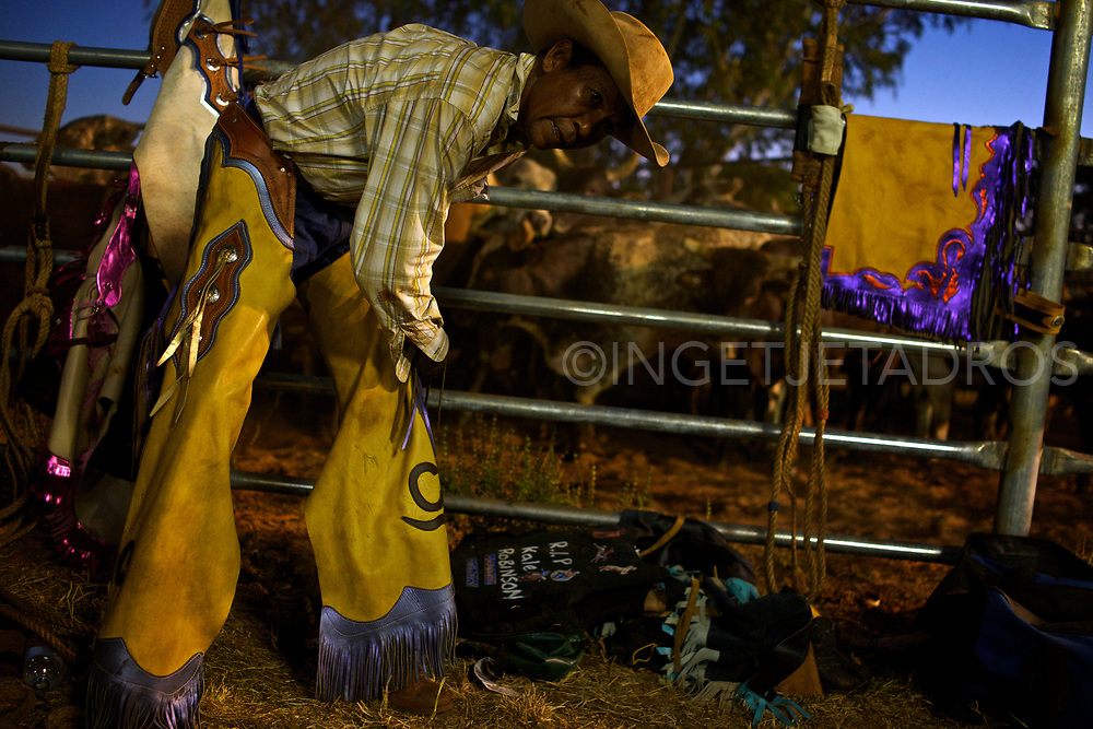 Cowboy preparing himself. Broome's Rodeo is action packed with open barrels, poddy ride, steer ride, steer wrestling, saddle bronc and bull ride. Broome, WA