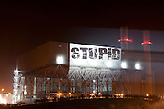 Campaigners projected the word STUPID on the side of Kingsnorth Power Station