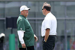 June 14, 2012; Florham Park, NJ, USA; New York Jets head coach Rex Ryan and general manager Mike Tannenbaum speak during New York Jets Minicamp at the Atlantic Health Training Center.