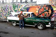 Car and graffiti in Havana Centro, Cuba.