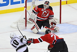 June 2; Newark, NJ, USA; New Jersey Devils goalie Martin Brodeur (30) makes a save on a shot by Los Angeles Kings center Mike Richards (10) during the first period of the 2012 Stanley Cup Finals Game 2 at the Prudential Center.