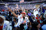 DENVER, CO - N.Y. Delegate Caroline Rowan (center, in white) cheers along with the crowd during the speech of N.M. Governor Bill Richardson at Invesco Field on Thursday August 28, 2008 in Denver, Co. on the final night of the 2008 Democratic National Convention. This is Rowan's second convention she's attended. Highlighted speakers on Wednesday evening included Howard Dean,.Former Governor of Vermont and Chair of the Democratic Party; Al Gore, former Vice President of the United States and the acceptance speech of Barack Obama as the Democratic Party candidate for President...(Photo by Marc Piscotty / © 2008)