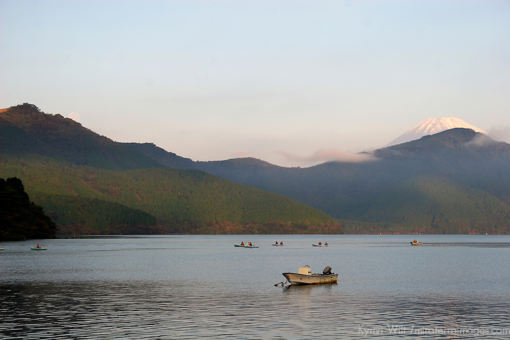 Asia, Japan, Hakone. Boats on Lake Ashi enjoy view of Mt. Fuji in early morning.